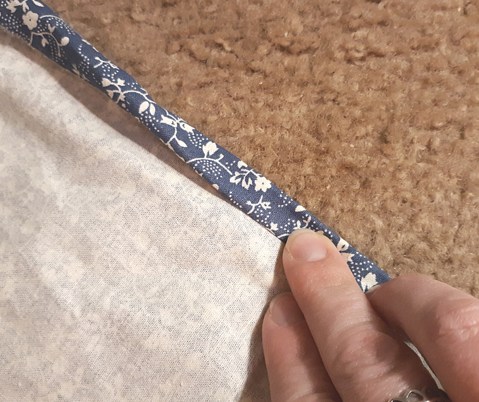 blue with white flowers fabric for the 1 hour apron with the edge folded over twice.