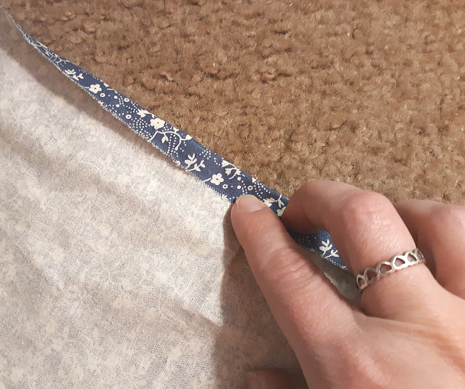 blue with white flowers fabric for the 1 hour apron with the edge folded over once.