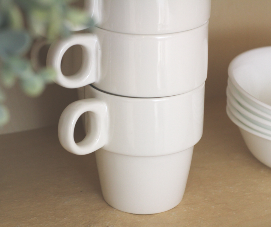 white stacked mugs