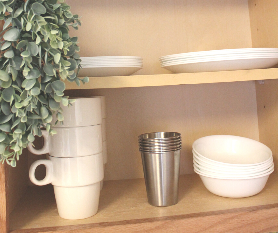white dishes in a cupboard to streamline a kitchen