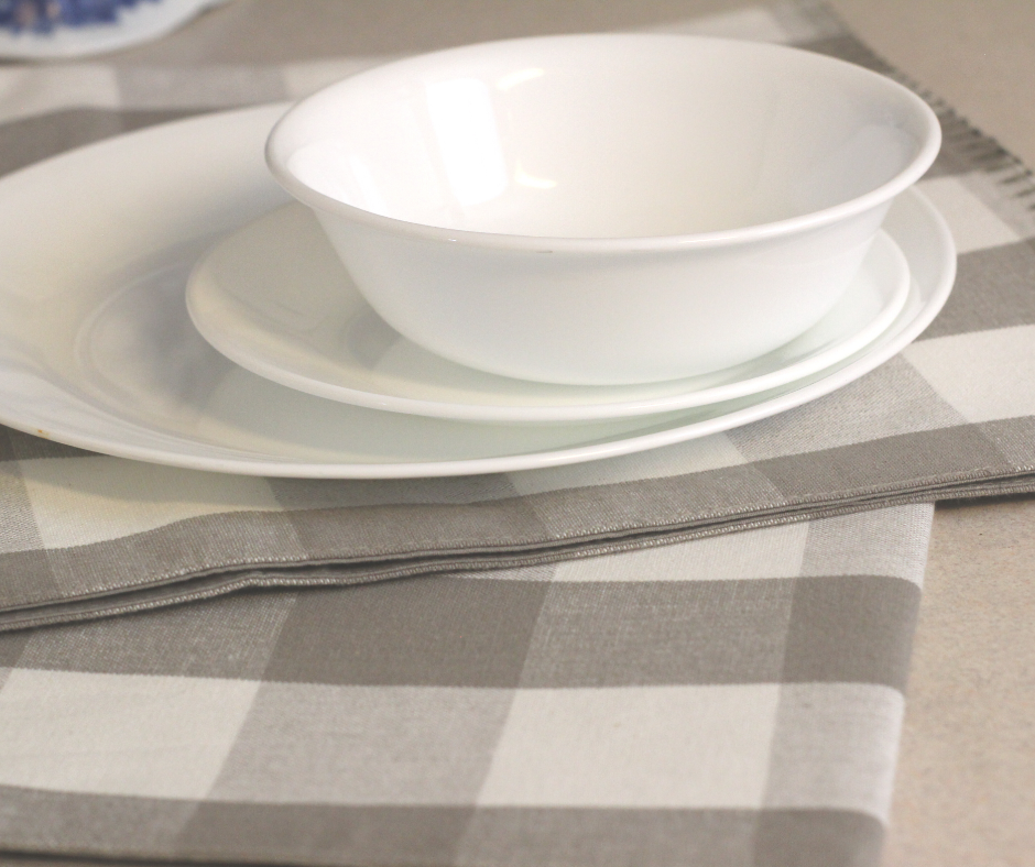 white dishes on a grey checkered cloth to streamline a kitchen