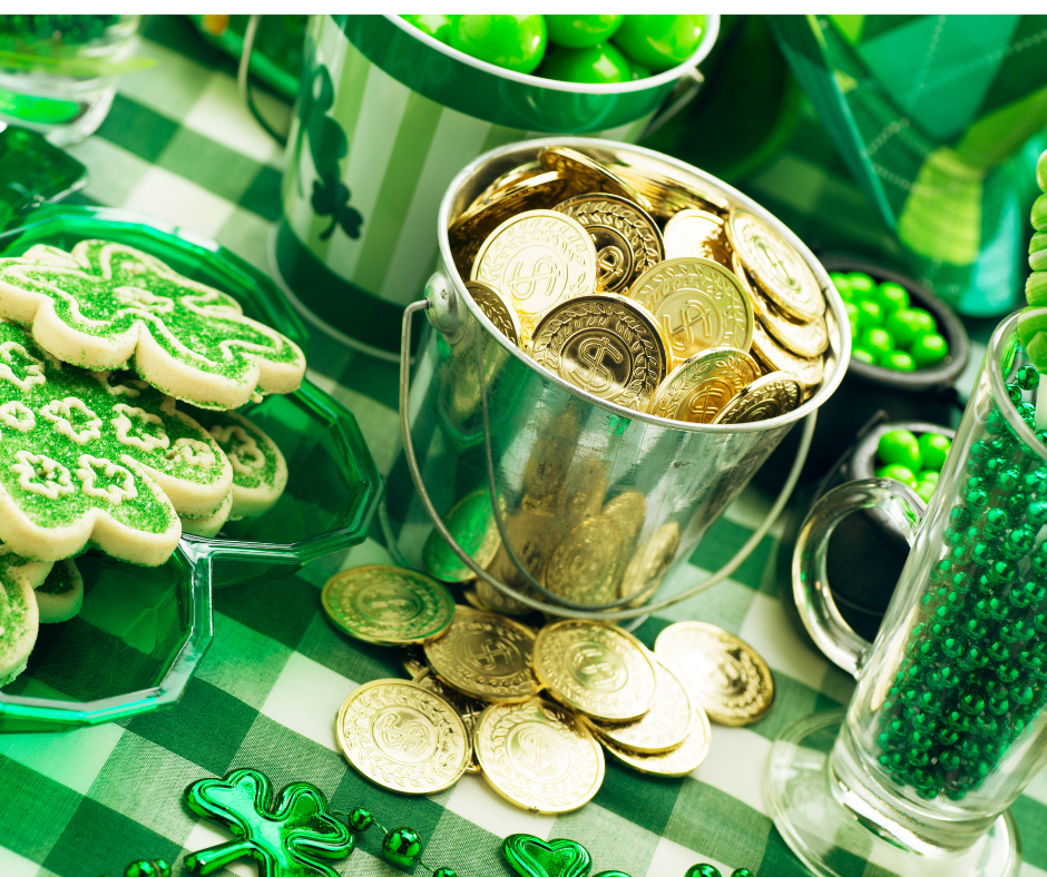 St. Patrick's Day table spread with candy, coins and cookies