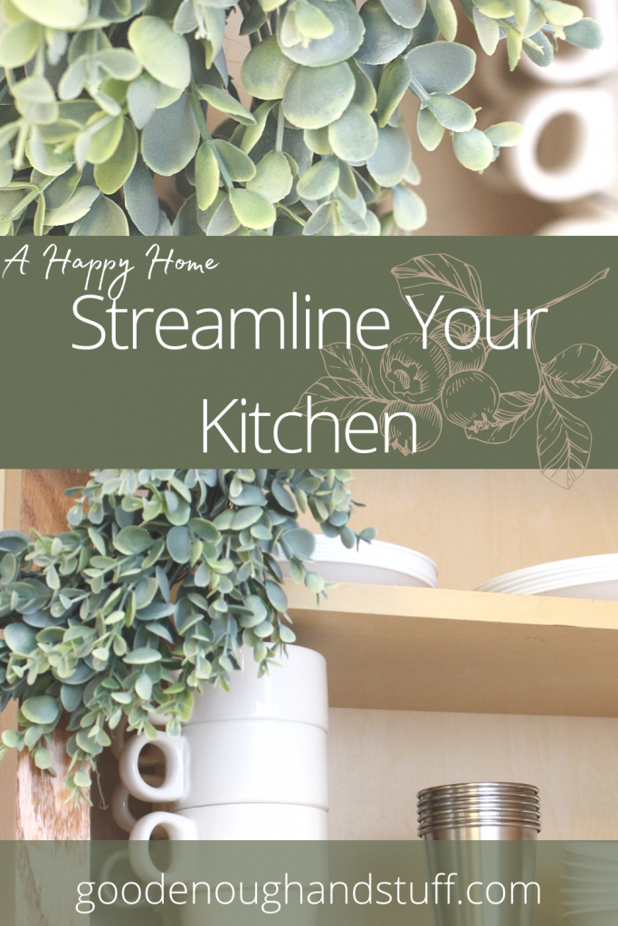 """white and metal dishes in a cupboard with greenery, with the words """"a happy home, streamline your kitchen"""""""