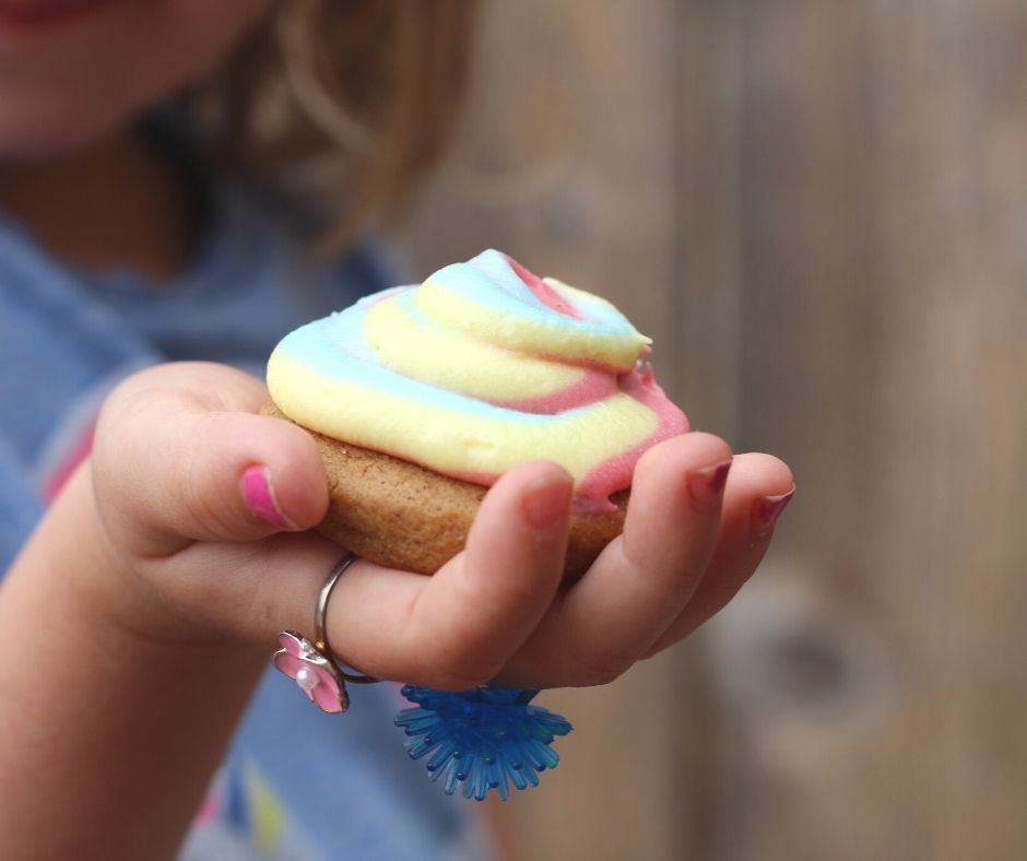 a child holding a cheesecake cookie