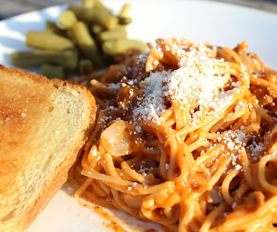 creamy spaghetti with cotija cheese on top