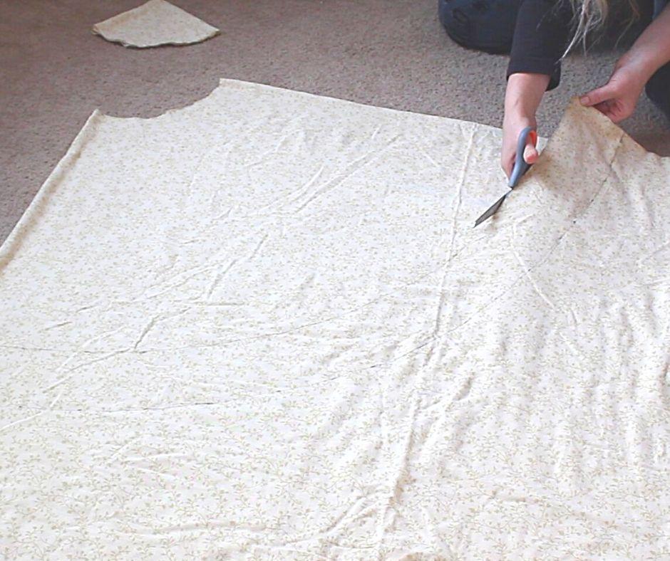 a woman cutting the fabric for a no-zipper skirt
