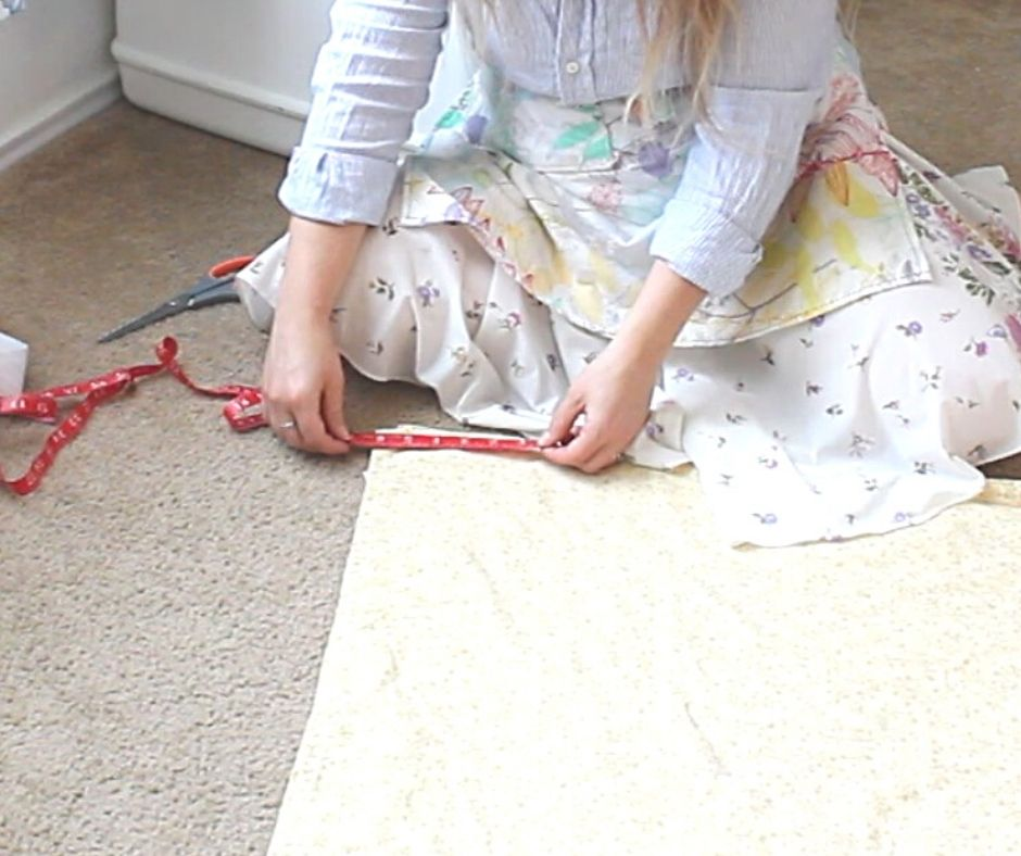 a woman measuring the waist band for a no-zipper skirt