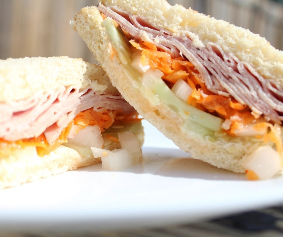 sandwich idea for summer with cucumber, ginger, carrots, onion, and ham on toast